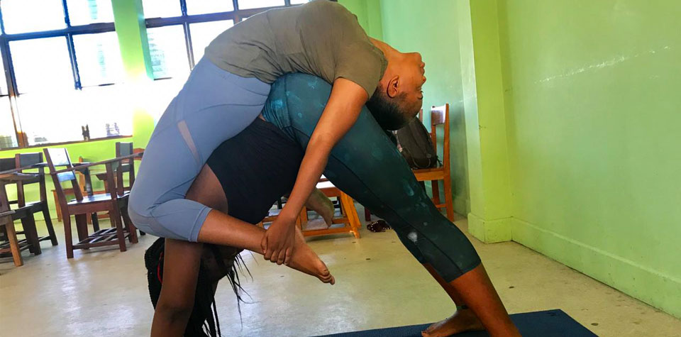 ROC Ambassador Eda Chang Arzu offers FREE yoga classes to University of Belize Students and Faculty